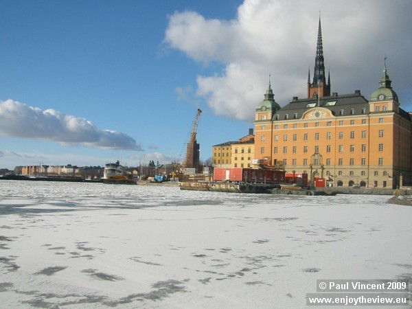 View towards islet of Riddarholmen, with spire of Riddarholmen Church, one of the oldest buildings i