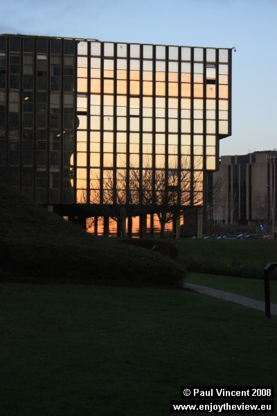 The bright sky creates an interesting reflection in this office block.