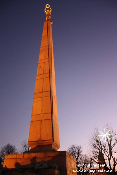 The Gëlle Fra ('Golden Lady') stands atop a 21 metre-tall granite obelisk.