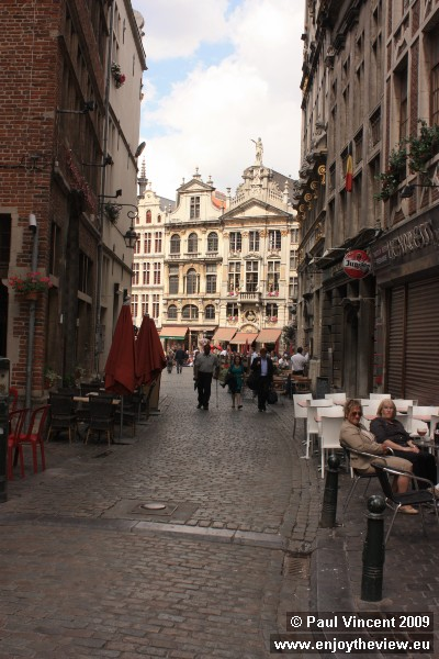 A cobbled street leading to the Grand Place.