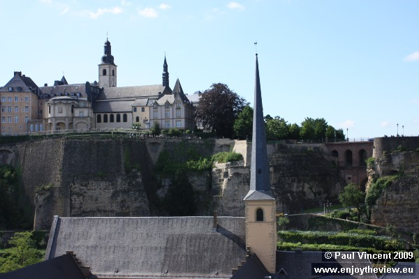 Uptown sits on the cliff, the spire is of the Abbaye de Neumünster.