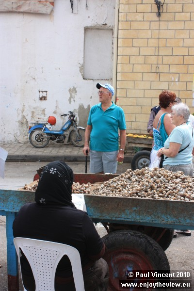 This lady is selling snails straight from a trailer.