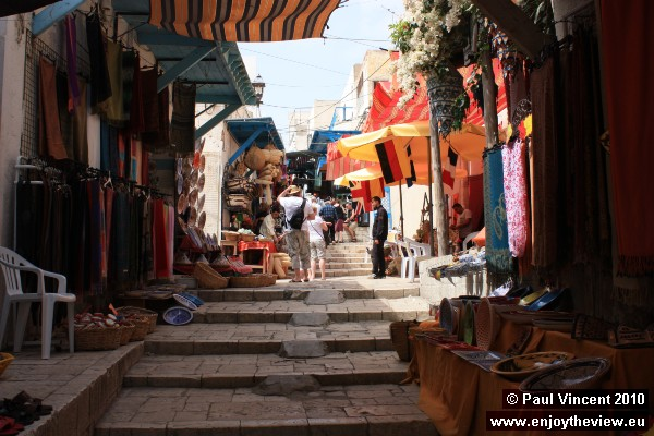 Souvenir shops on a hilly street in the Sousse medina.