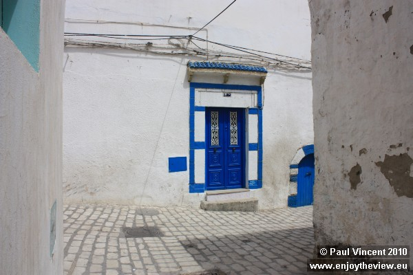 A typical Tunisian colour scheme, the blue doors contrast well with the white wash walls.