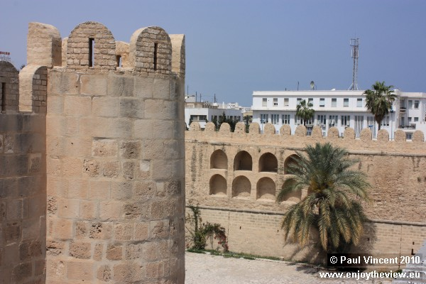 A corner of the mosque, and the medina's outer wall behind.