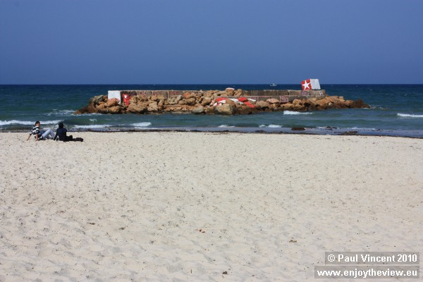 A breakwater decorated with the colours of the Tunisian flag.