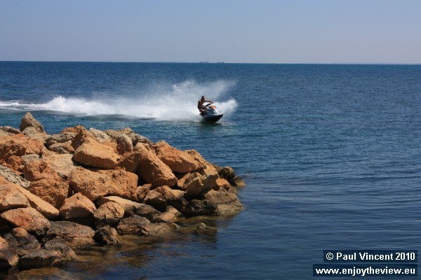 A water-skier arrives back at the marina.