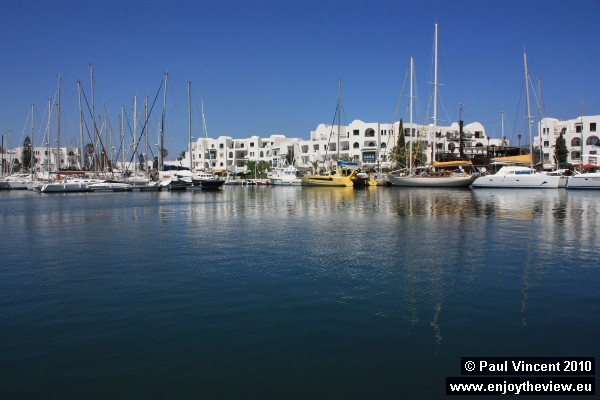 The white buildings of Port El Kantaoui contrast with the blueness of the sea and sky.