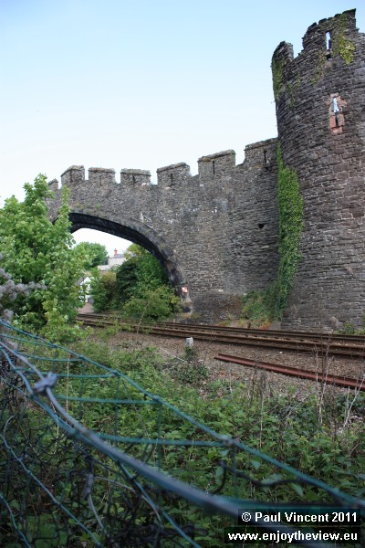 The North Wales Coast line runs along the southern edge of the castle.