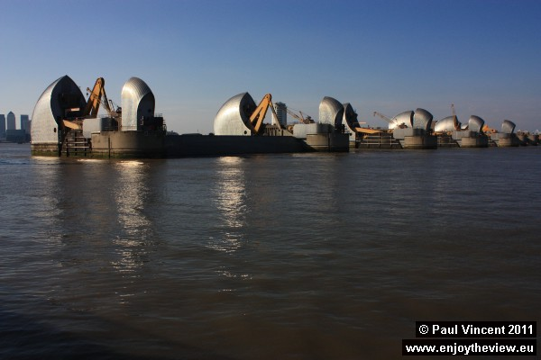The sun shines off the Thames Barrier, seen here from the east.