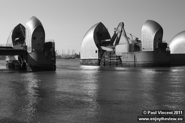 The o2, formerly Millennium Dome, can be seen here between the Thames Barrier's piers.