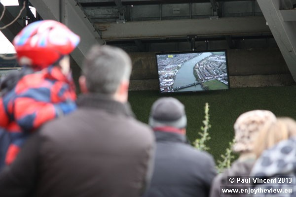 Screens at Fulham Football Club show the University Boat Race, which passes the stadium.