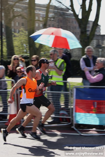 Blind runners and their guides, connected a tether, received some of the biggest cheers.