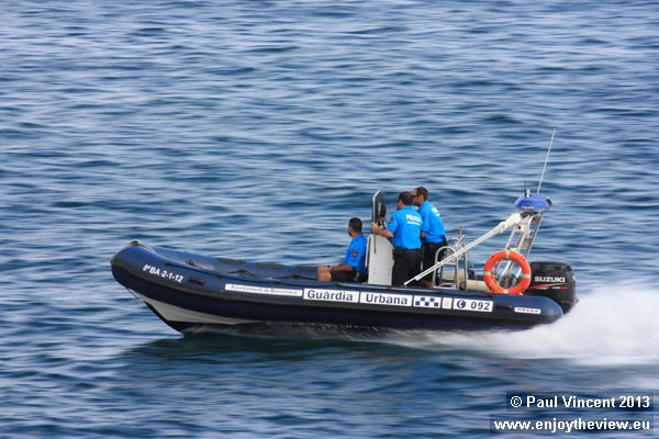 Police patrolling the Barcelona shore.