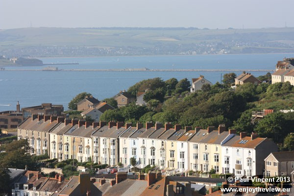 Portland Harbour can be seen in the backdrop.