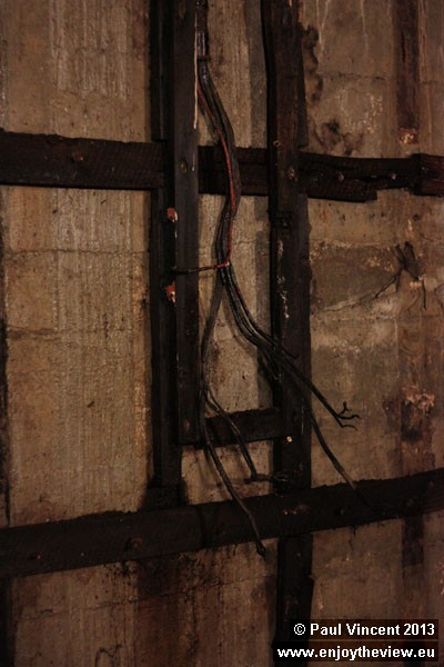 Loose electrical wiring along the walls.