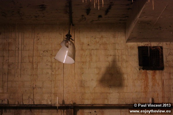 A broken lamp shade in the kitchen area of the bunker.