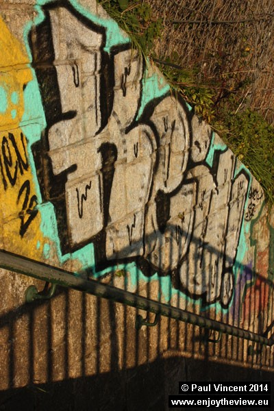 Graffiti alongside the steps rising from the north bank of the Douro River.