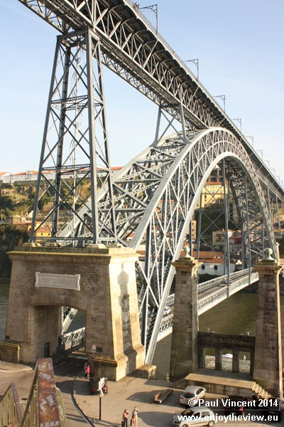 The pillars of an old bridge can be seen alongside the current Dom Luís Bridge.