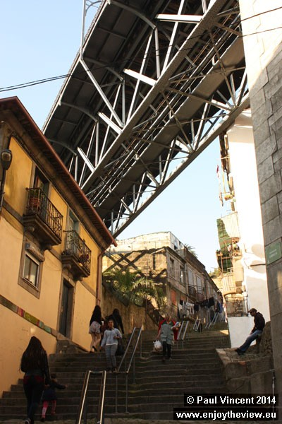 The Dom Luís Bridge passes over residential streets on either side of the Douro.