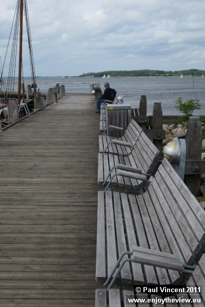Benches on a pier at Roskilde marina.