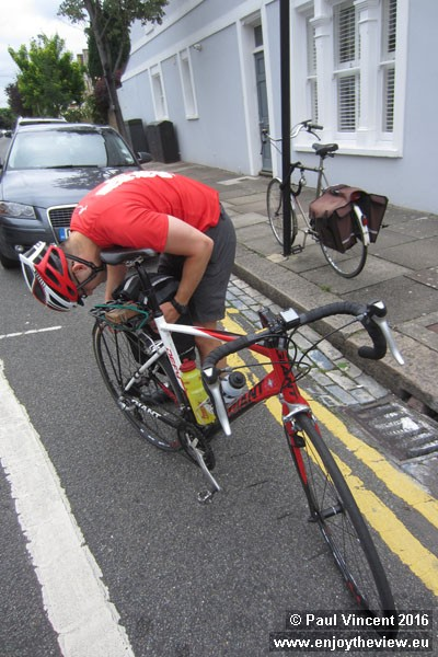With minutes until departure, Gareth finally attempts, with some difficulty, to attach his pannier.