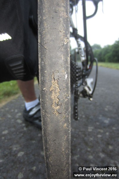 An hour after departing Dieppe, Gareth suddenly discovers that his rear tyre is beginning to shred.