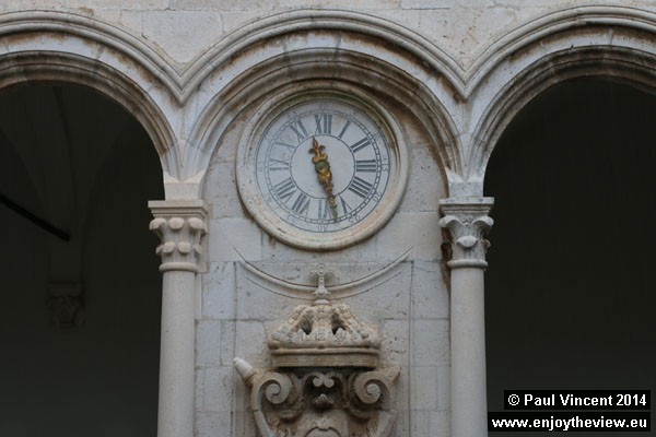 A clock within the courtyard of the Rector's Palace.
